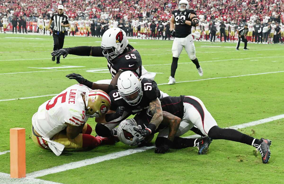 GLENDALE, ARIZONA - OCTOBER 10: Trey Lance #5 of the San Francisco 49ers is stopped at the 1-yard line on fourth down against the Arizona Cardinals during the first quarter at State Farm Stadium on October 10, 2021 in Glendale, Arizona. (Photo by Norm Hall/Getty Images)
