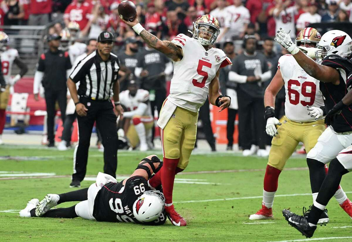 GLENDALE, ARIZONA - OCTOBER 10: Trey Lance #5 of the San Francisco 49ers throws a pass during the second quarter under pressure from J.J. Watt #99 of the Arizona Cardinals at State Farm Stadium on October 10, 2021 in Glendale, Arizona. (Photo by Norm Hall/Getty Images)