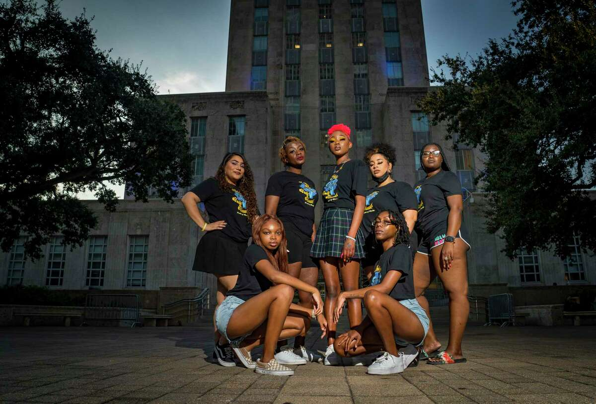 Back row, from left, Stephany Valdez, Mia Williams, Nia Jones, Chris Caldwell, Crystal A., (bottom row, left to right) Donavyn Hightower and Jermaya Banks, all members of Hoochies of Houston, a grassroots organization advocating for Black women, stand outside of Houston's city hall building, Friday, Oct. 8, 2021. The group alleges that after being asked to co-organize the recent Houston Women's March, their members were disrespected during the process and actual event.