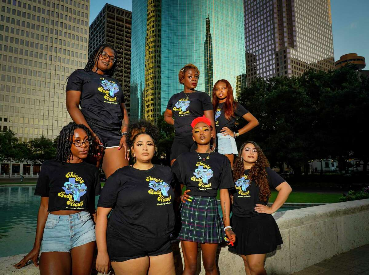 (Top row, left to right) Crystal A., Mia Williams and Donavyn Hightower, (Bottom row, left to right) Jermaya Banks, Chris Caldwell, Nia Jones and Stephany Valdez, all members of Hoochies of Houston, a grassroots organization advocating for Black women, stand outside of Houston's city hall building, Friday, Oct. 8, 2021. The group alleges that after being asked to co-organize the recent Houston Women's March, their members were disrespected during the process and actual event.