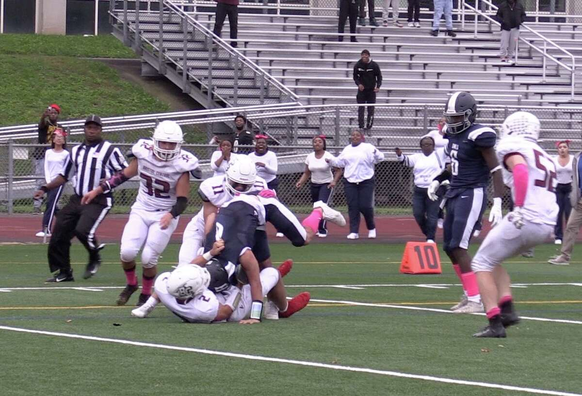 Bristol Central's Victor Rosa vs. Hartford Public's Christian Garcia on the final play of BC's 52-48 victory in Hartford on Saturday, Oct. 9, 2021.