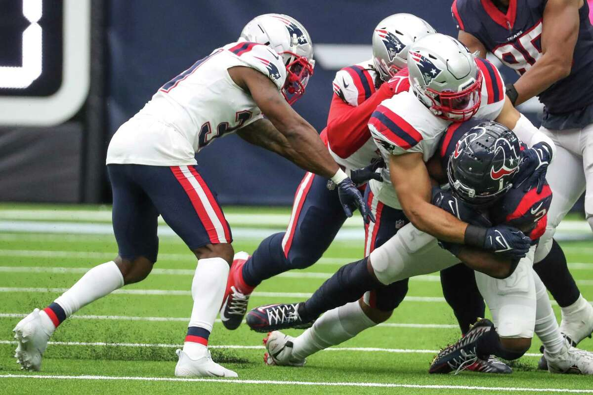 Houston Texans running back Mark Ingram II (2) is stopped after a short gain by the New England Patriots defense during the second half of an NFL football game Sunday, Oct. 10, 2021, in Houston.