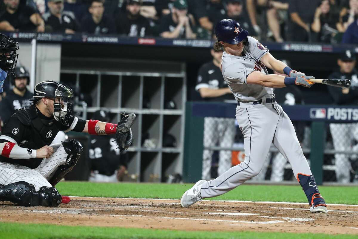 Houston Astros center fielder Jake Meyers (6) hits and RBI single off Chicago White Sox starting pitcher Dylan Cease (84), scoring Kyle Tucker during the inning in Game 3 of the American League Division Series Sunday, Oct. 10, 2021, in Chicago.
