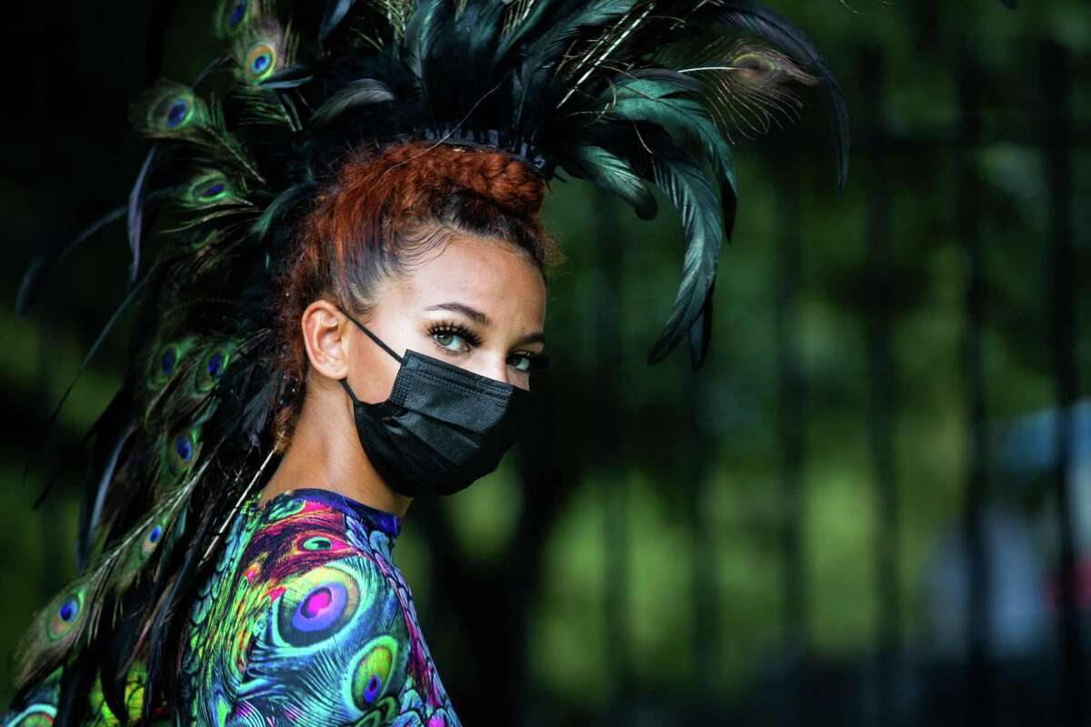 Carver Aldine Dance Company dancer Shamiria Gregory performs as a peacock at the Bayou City Art Festival by the Sam Houston Park, Sunday, Oct. 10, 2021, in Houston.