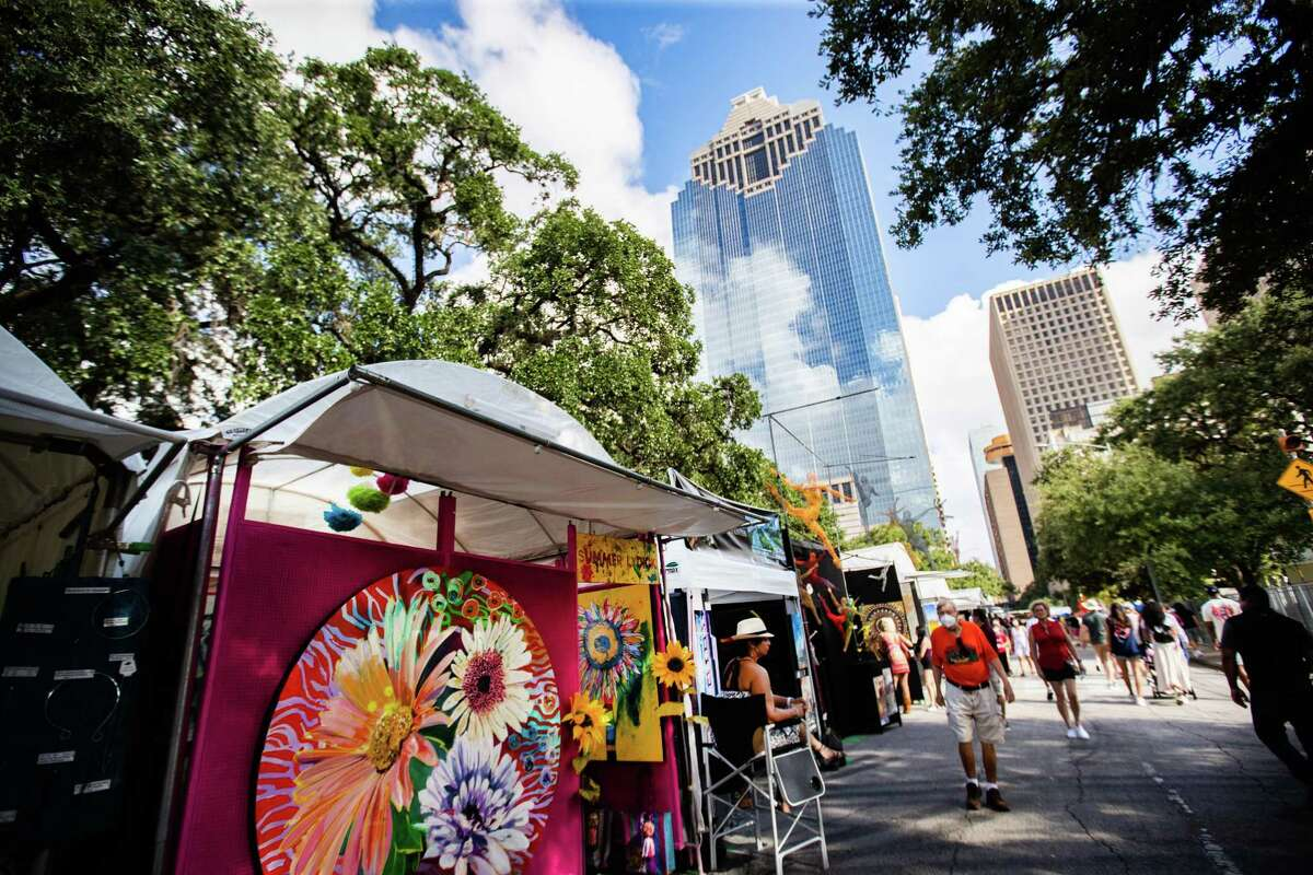 Art vendors display their art during the Bayou City Art Festival, Sunday, Oct. 10, 2021, in Houston.