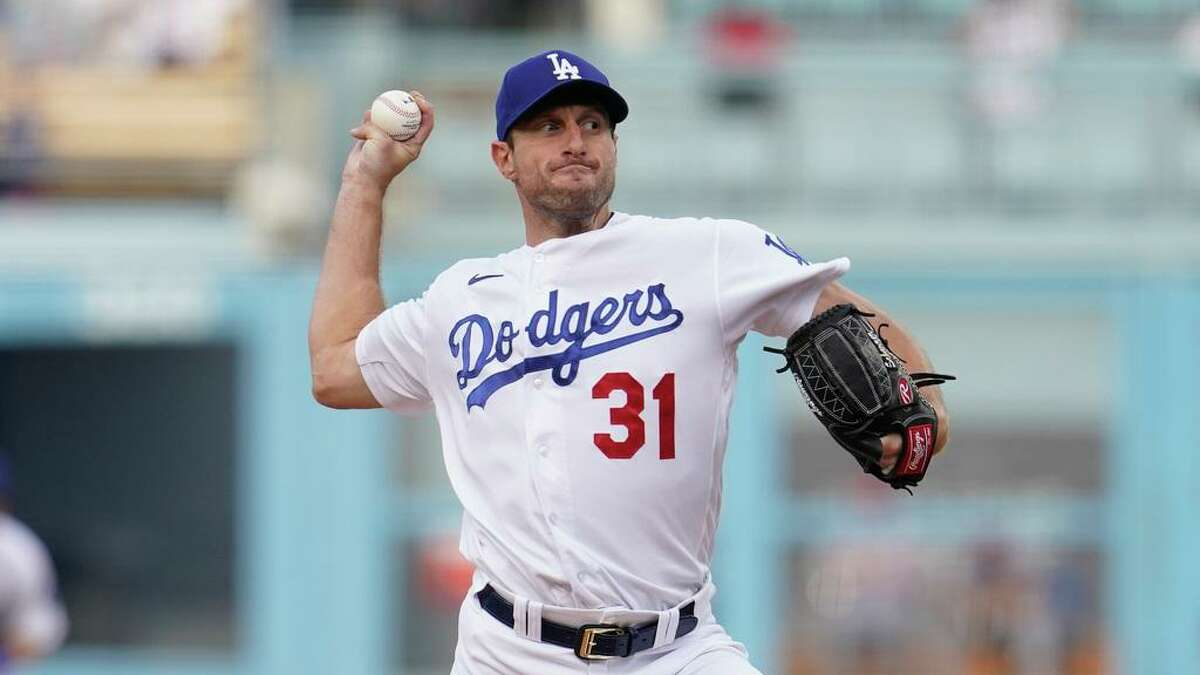 Los Angeles Dodgers starting pitcher Max Scherzer (31) throws during the first inning of a National League Wild Card playoff baseball game against the St. Louis Cardinals Wednesday, Oct. 6, 2021, in Los Angeles. (AP Photo/Marcio Jose Sanchez)