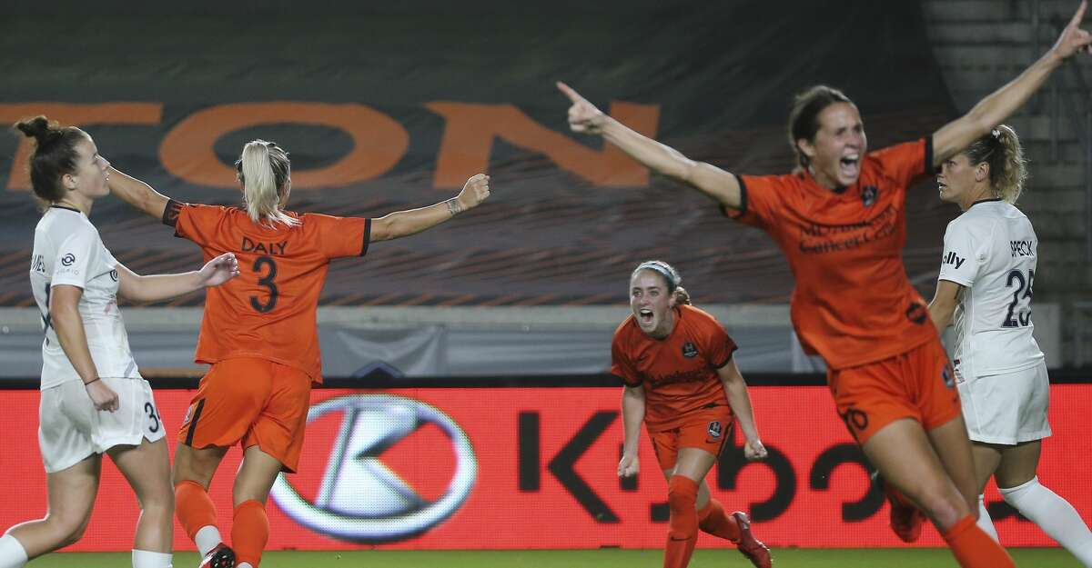 Houston Dash forward Rachel Daly, from left, Brianna Visalli and Shea Groom react to Daly's goal with Visalli's assist during the second half of the NWSL match against the North Carolina Courage Sunday, Oct. 10, 2021, at BBVA Stadium in Houston. Houston Dash defeated North Carolina Courage 4-1.