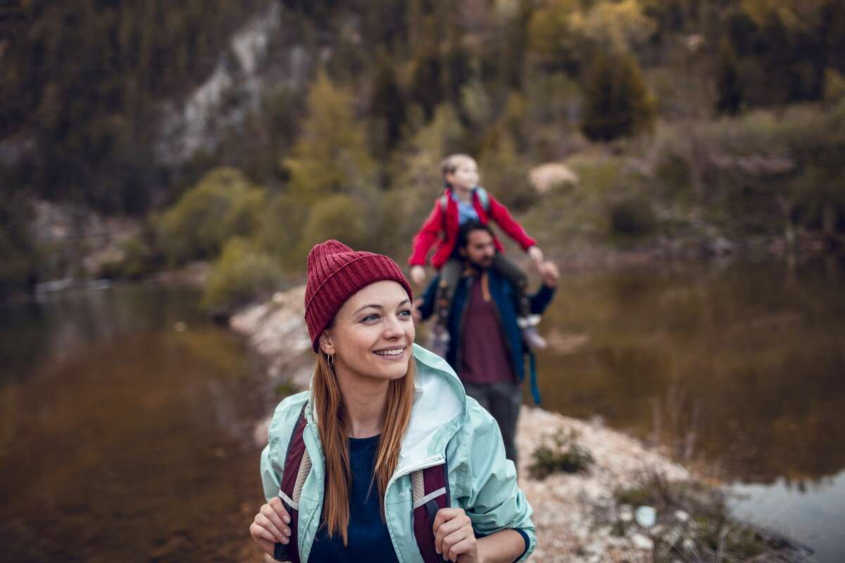 Close up of a young family hiking next to a lake