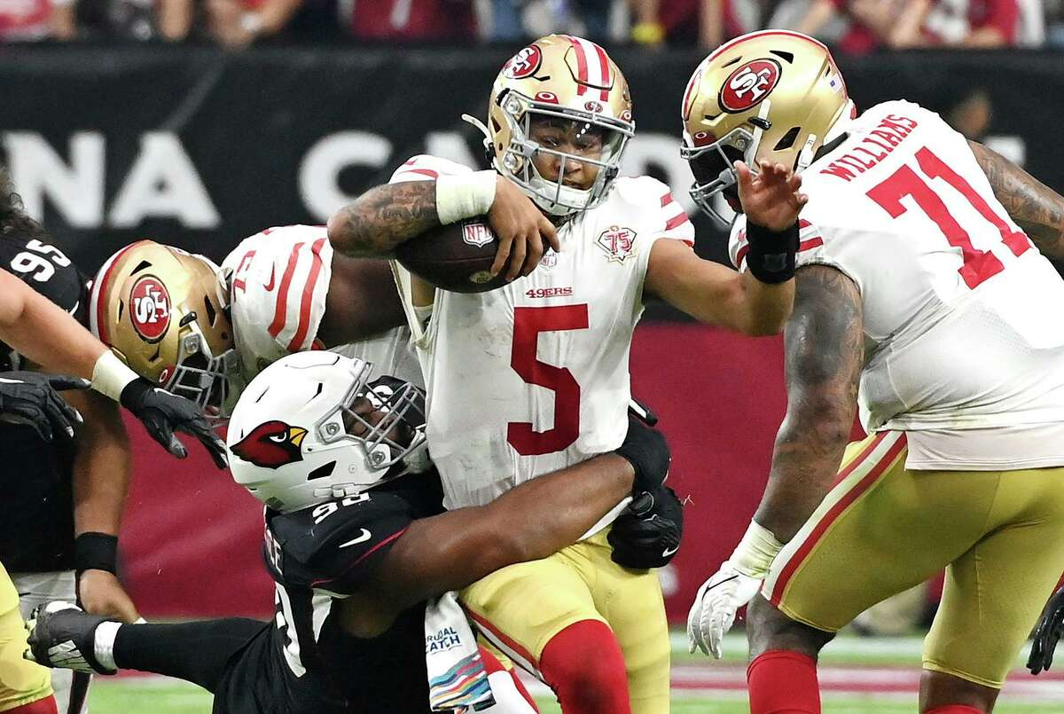 49ers quarterback Trey Lance (5) is tackled by the Cardinals' Rashard Lawrence during the fourth quarter. Lance relied heavily on his legs and speed and was less confident in his arm.