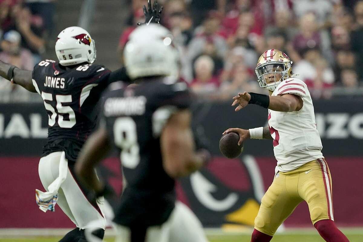 San Francisco 49ers quarterback Trey Lance (5) throws under pressure from Arizona Cardinals linebacker Chandler Jones (55) during the second half of an NFL football game, Sunday, Oct. 10, 2021, in Glendale, Ariz. (AP Photo/Darryl Webb)