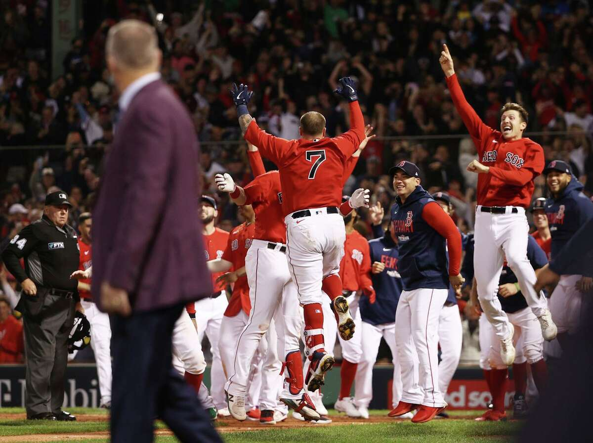 Boston's Christian Vazquez (7) celebrates his game-winning two-run home run with teammates in the 13th inning at Fenway Park. Boston now leads the best-of-five series 2-1.