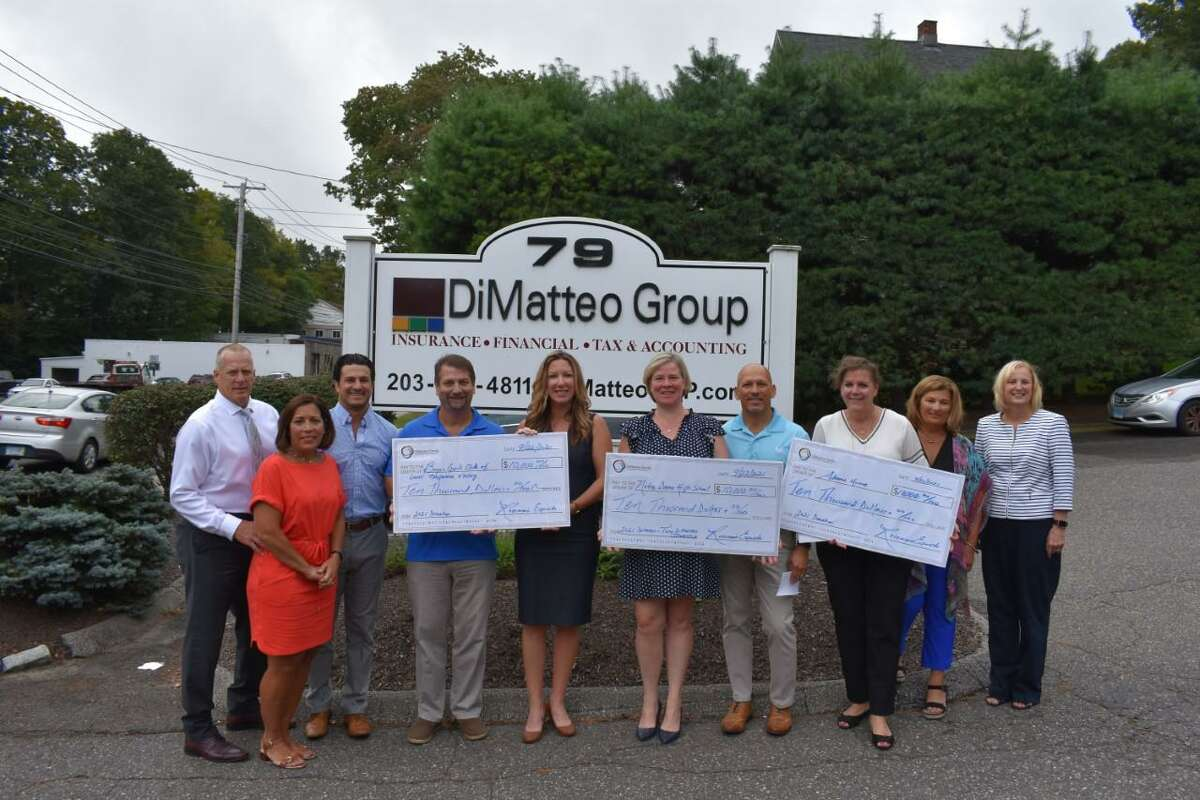 The DiMatteo Family Charitable Foundation this year contributed $10,000 each to the Boys & Girls Club of the Lower Naugatuck Valley and Adam's House, both located in Shelton, and the Tony DiMatteo Scholarship Fund.Pictured, left to right, are Robert and Loretta Lesko of Shelton, John Esposito of Middlebury, John Schaible of Milford and Shaye Roscoe of Shelton, Executive Director, both affiliated with the Boys and Girls Club of the Lower Naugatuck Valley; Julie Coyle Davis of Stratford, Advancement Director, Notre Dame High School; John DiMatteo of Bethany, Allison Wysota of Milford, founder and Executive Director of Adam's House; Rosemarie Esposito of Shelton, and Arlene Greco of Naugatuck, Adam's House.