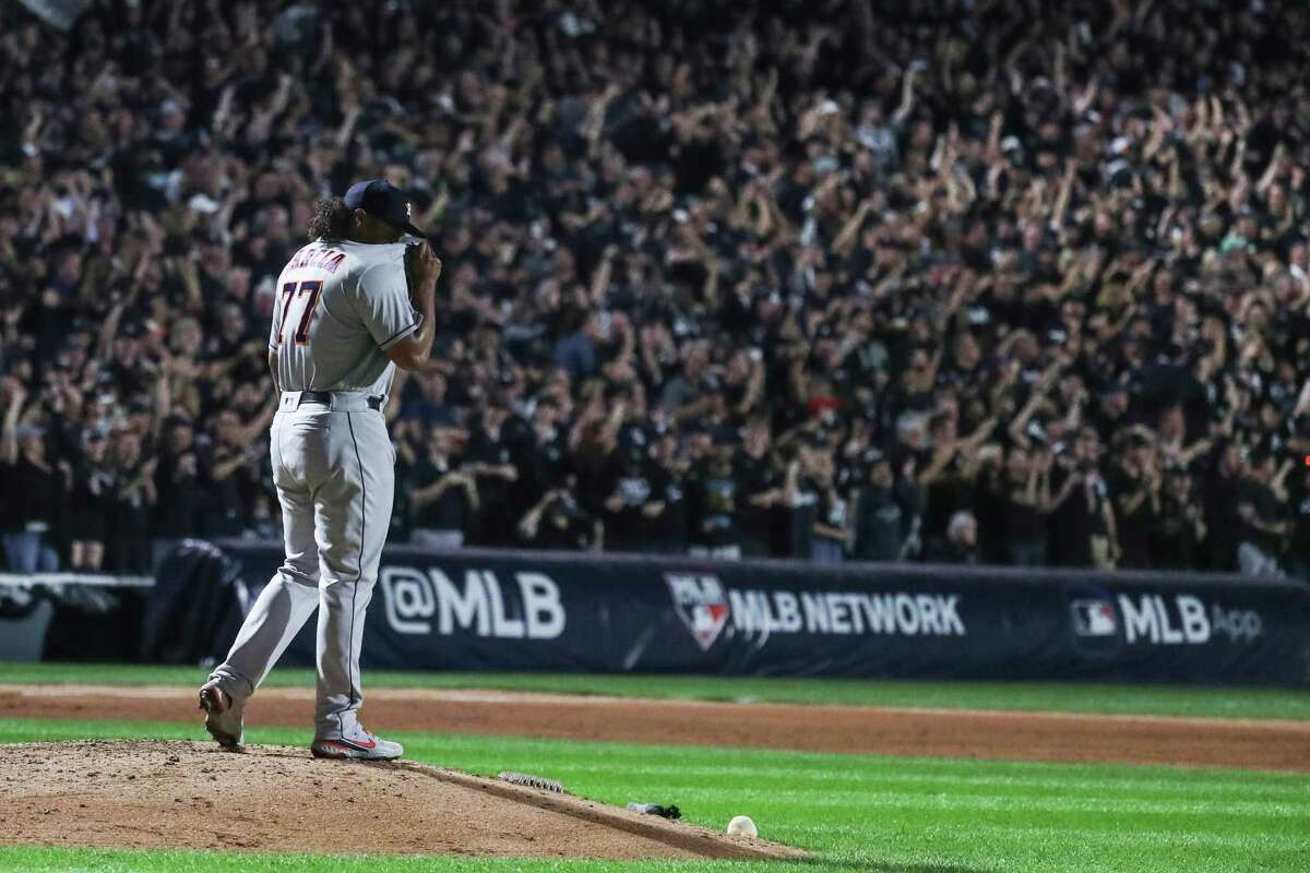 Houston Astros starting pitcher Luis Garcia (77) reacts after giving up a 2-run home run by Chicago White Sox catcher Yasmani Grandal during the third inning in Game 3 of the American League Division Series Sunday, Oct. 10, 2021, in Chicago.