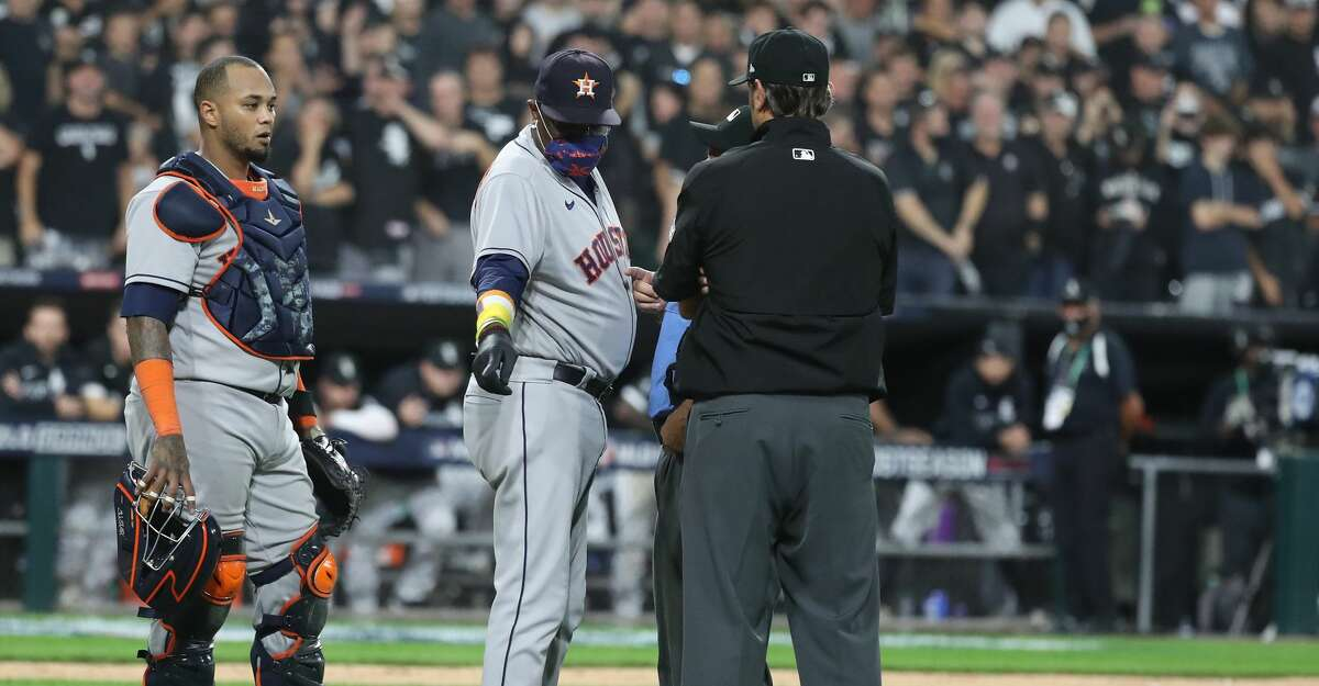 Houston Astros manager Dusty Baker Jr. (12) argues for an interference call as a throw home by Houston Astros first baseman Yuli Gurriel hit the batter and a run scored during the fourth inning in Game 3 of the American League Division Series Sunday, Oct. 10, 2021, in Chicago.