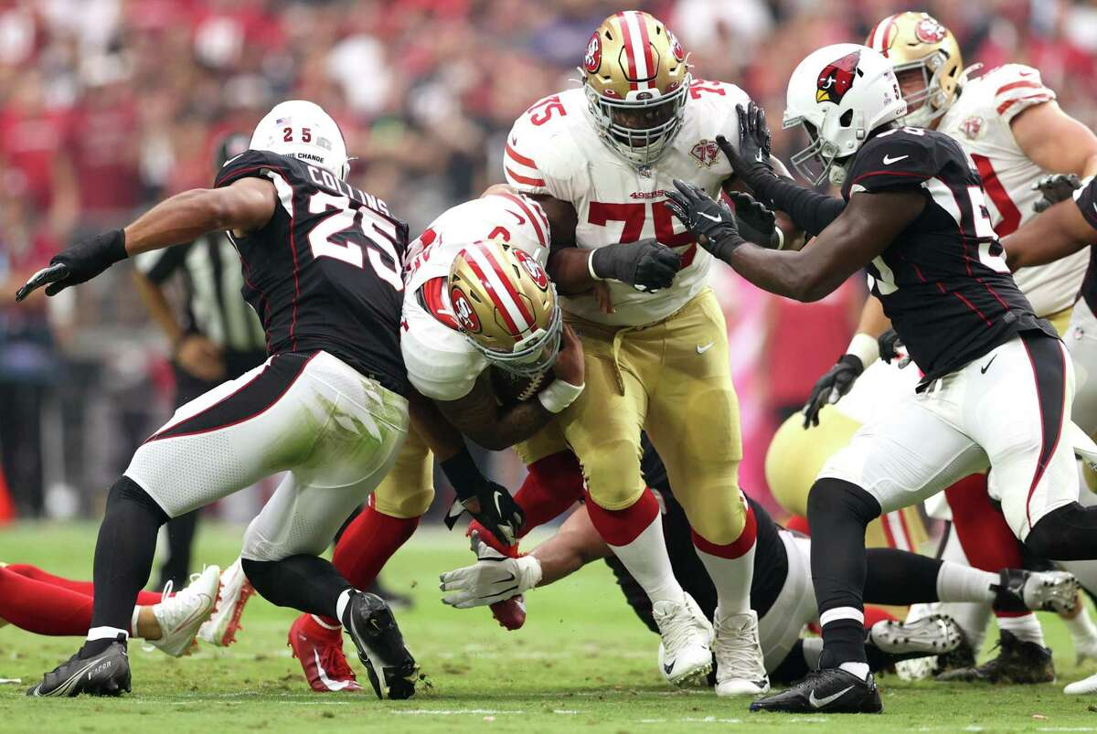 Niners quarterback Trey Lance is tackled short of the first-down marker on a fourth-down carry in the first quarter. The 49ers were 1-for-5 on fourth-down plays in the game.