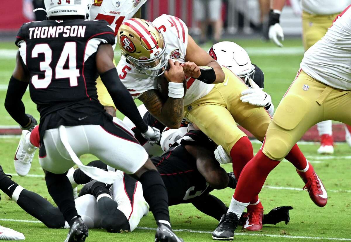 Niners quarterback Trey Lance #5 of the San Francisco 49ers is tackled on fourth down against the Arizona Cardinals during the first quarter at State Farm Stadium on October 10, 2021 in Glendale, Arizona. (Photo by Norm Hall/Getty Images)