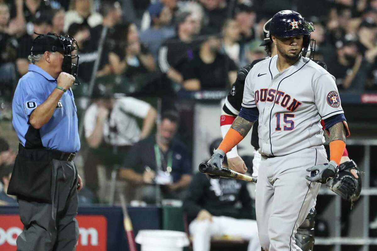 Houston Astros catcher Martin Maldonado (15) is called out on strike by umpire Tom Hallion during the sixth inning in Game 3 of the American League Division Series against the Chicago White Sox Sunday, Oct. 10, 2021, in Chicago.