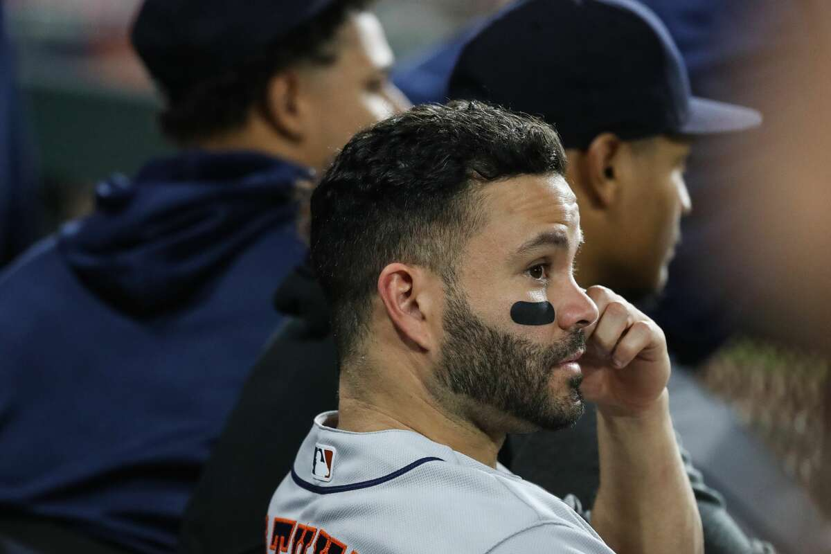 Houston Astros second baseman Jose Altuve sits in the dugout during the seventh inning against the Chicago White Sox in Game 3 of the American League Division Series Sunday, Oct. 10, 2021, in Chicago.