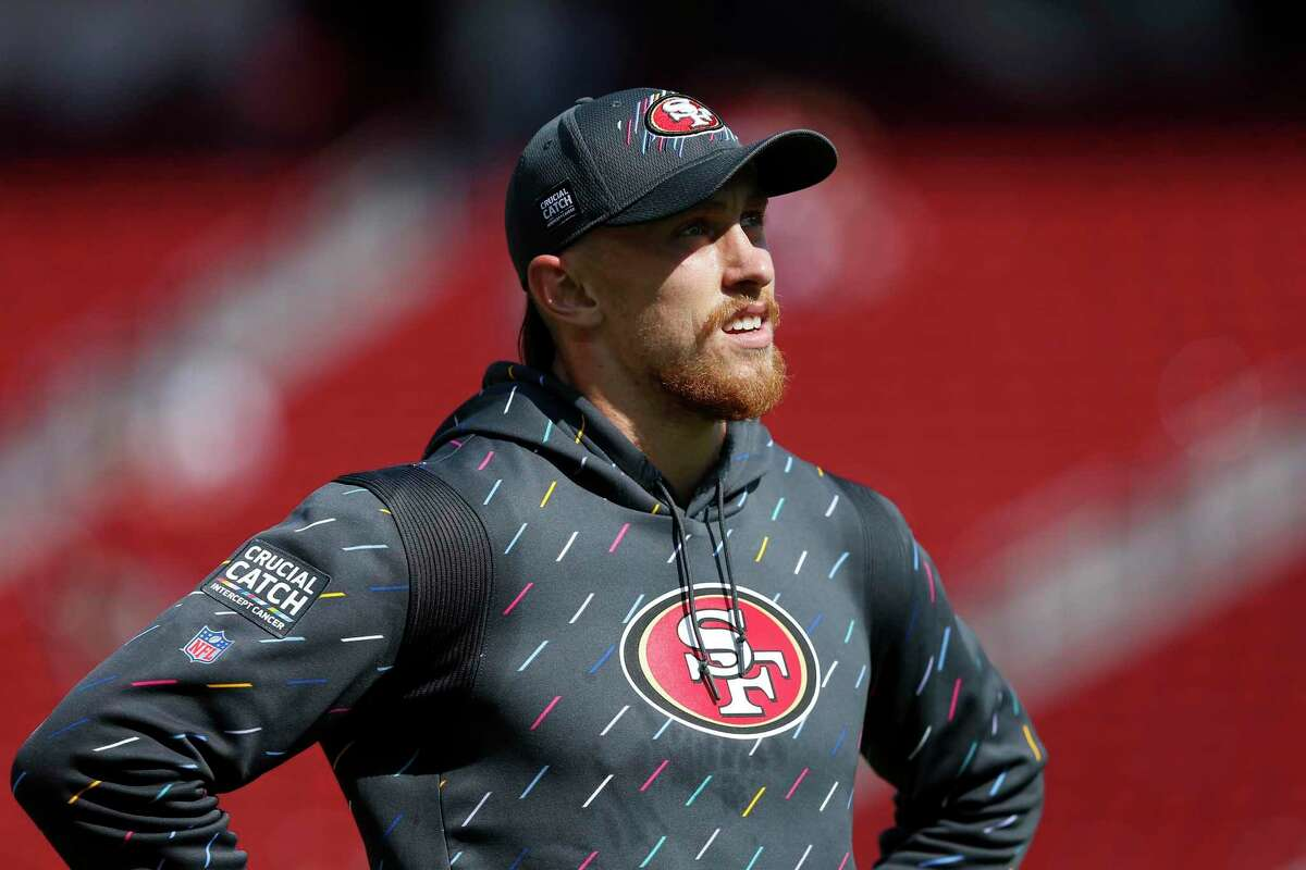 San Francisco 49ers tight end George Kittle (85) walks on the field wearing a Crucial Catch hoody before an NFL football game against the Seattle Seahawks, Sunday, Oct. 3, 2021 in Santa Clara, Calif. (AP Photo/Lachlan Cunningham)