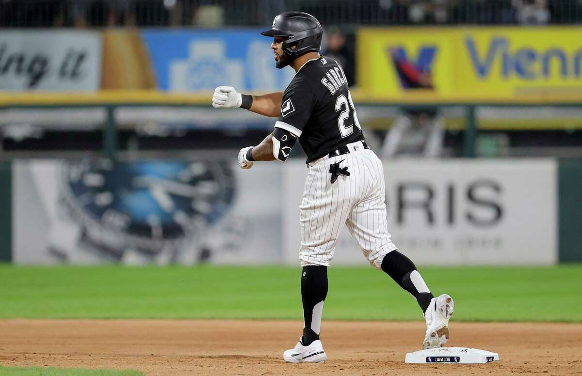White Sox outfielder Leury Garcia celebrates his RBI double in the eighth inning. Garcia's hit was part of a three-run outburst that gave host Chicago more breathing room against Houston.