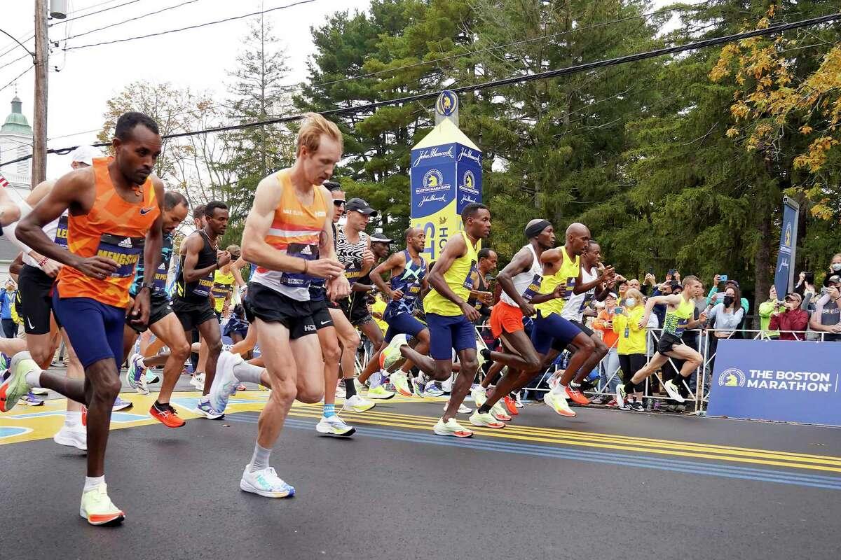 The elite men break from the starting line of the 125th Boston Marathon, Monday, Oct. 11, 2021, in Hopkinton, Mass.