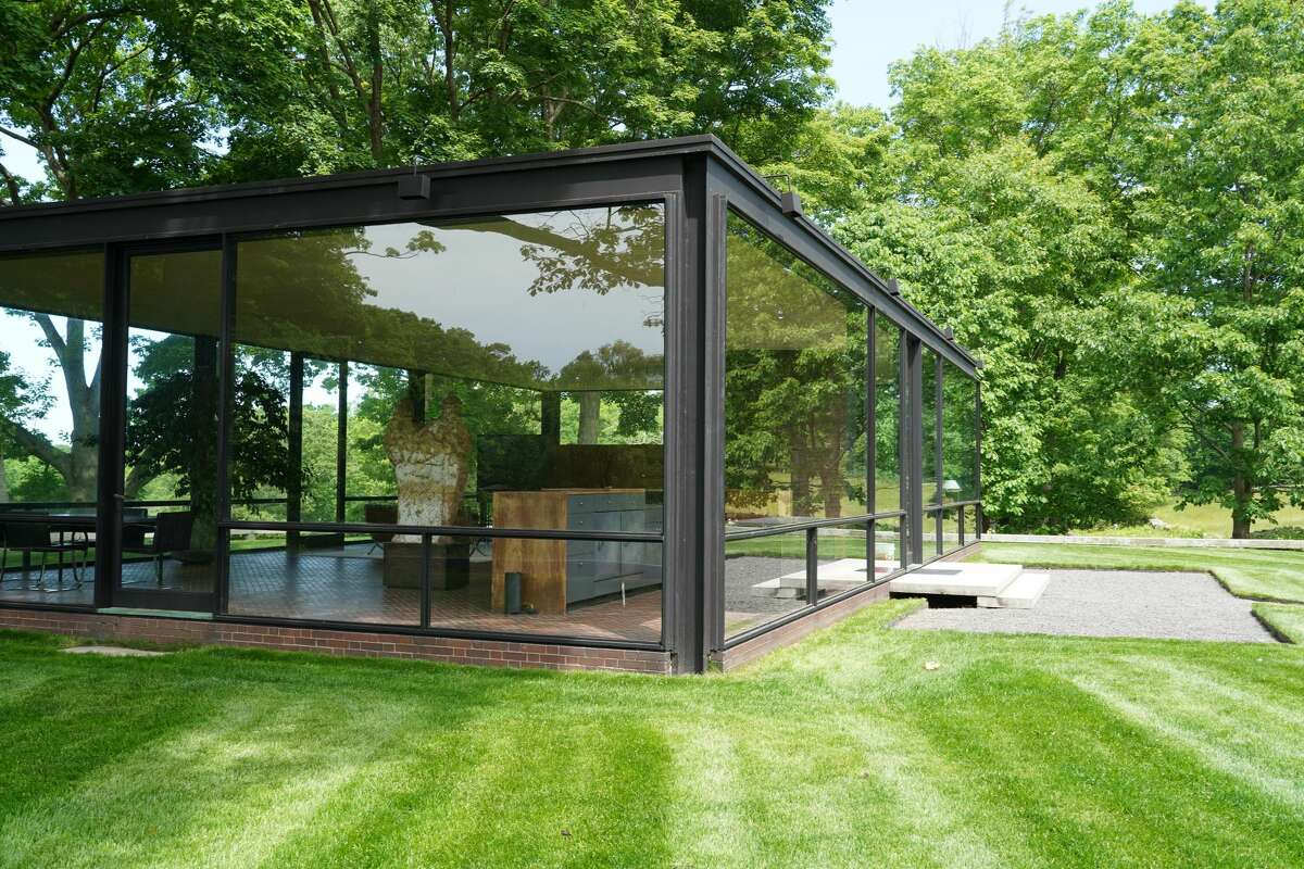 The Glass House in New Canaan, completed in 1949 by renowned Mid-century architect Philip Johnson, is a rectangular, symmetrical one-story building, primarily enclosed with steel-framed glass with a brick cylinder structure for a fireplace and bathroom. The picture was taken Thursday, June 4, 2020