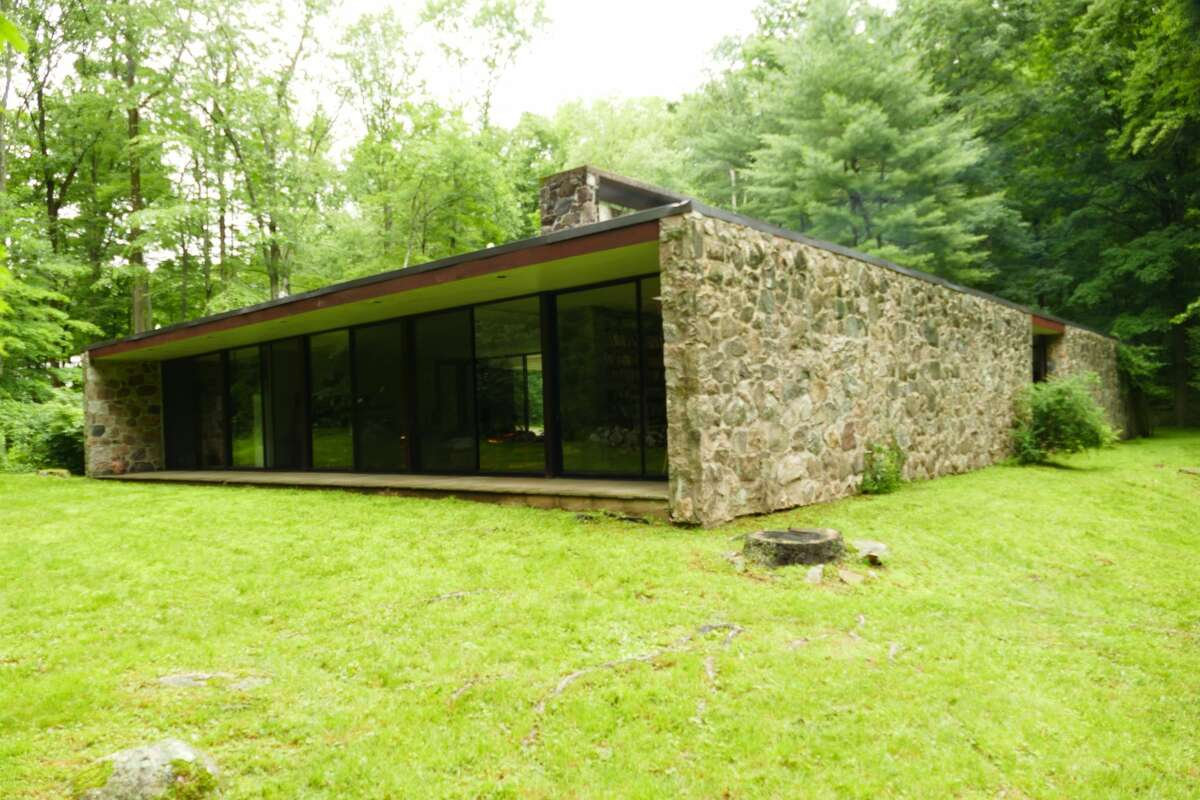 The Eliot Noyes home is an example of a mid-century modern house - which highlights the natural setting.
