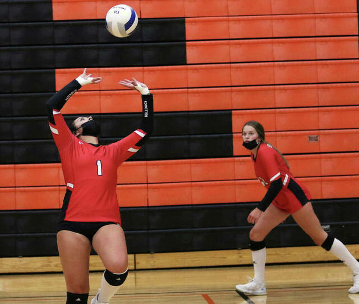 Staunton's Kennedy Legendre (right) heads to the net while teammate Savannah Billings sets during a match at the Edwardsville Tournament on Sept. 3. Legendre earned all-tourney honors Saturday while the Bulldogs won the Macoupin County Tourney for a fourth successive season.