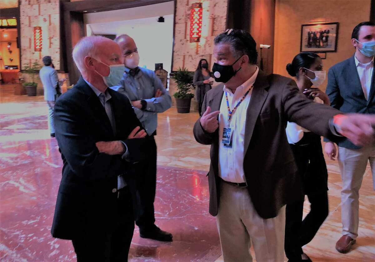 U.S. Rep. Joe Courtney, D-2, left, chats with Chuck Bunnell, chief of staff of the Mohegan Tribe.
