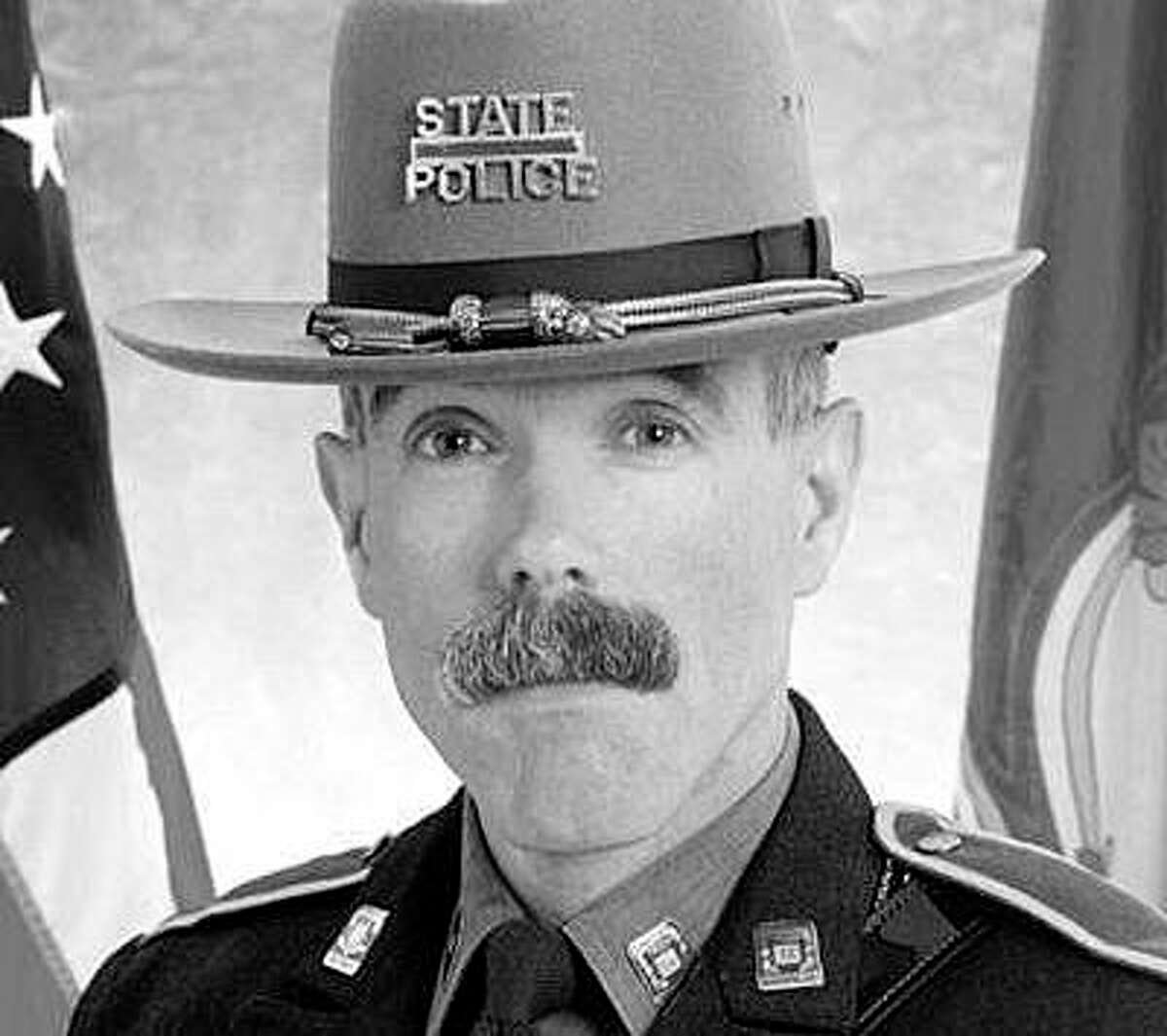 """State police announced Sunday the death of Sgt. Llewellyn """"Llew"""" Rowe Jr. He died on Sept. 7, 2021, at the age of 65 after a battle with cancer, state police and his obituary said."""