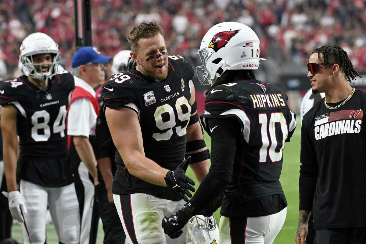 DeAndre Hopkins and J.J. Watt celebrate a Hopkins touchdown on Sunday against the 49ers. Hopkins and Watt are thriving in Arizona as the Cardinals are the only undefeated team in the league.