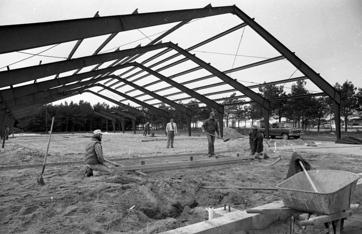 The Veterans of Foreign Wars Walsh Post #4499 is continuing construction on its new building at the corner of 28th and Nelson streets. Gary Schrader (left), Pete Schrader (right), and George Stapleton (second from right) level sand prior to pouring cement as John Konicki looks on. The photo was published in the News Advocate on Oct. 12, 1981. (Manistee County Historical Museum photo)