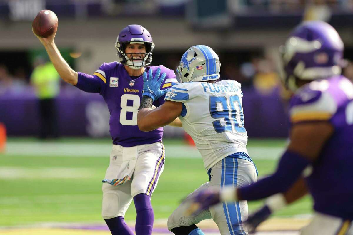 MINNEAPOLIS, MINNESOTA - OCTOBER 10: Kirk Cousins #8 of the Minnesota Vikings throws the ball during the fourth quarter against the Detroit Lions at U.S. Bank Stadium on October 10, 2021 in Minneapolis, Minnesota. (Photo by Adam Bettcher/Getty Images)