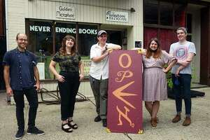 """Fabian Menges (left), Elena Augusewicz, Peter Cunningham, Jules Bakes and Conor Perreault, part of the """"collective"""" keeping Never Ending Books alive."""