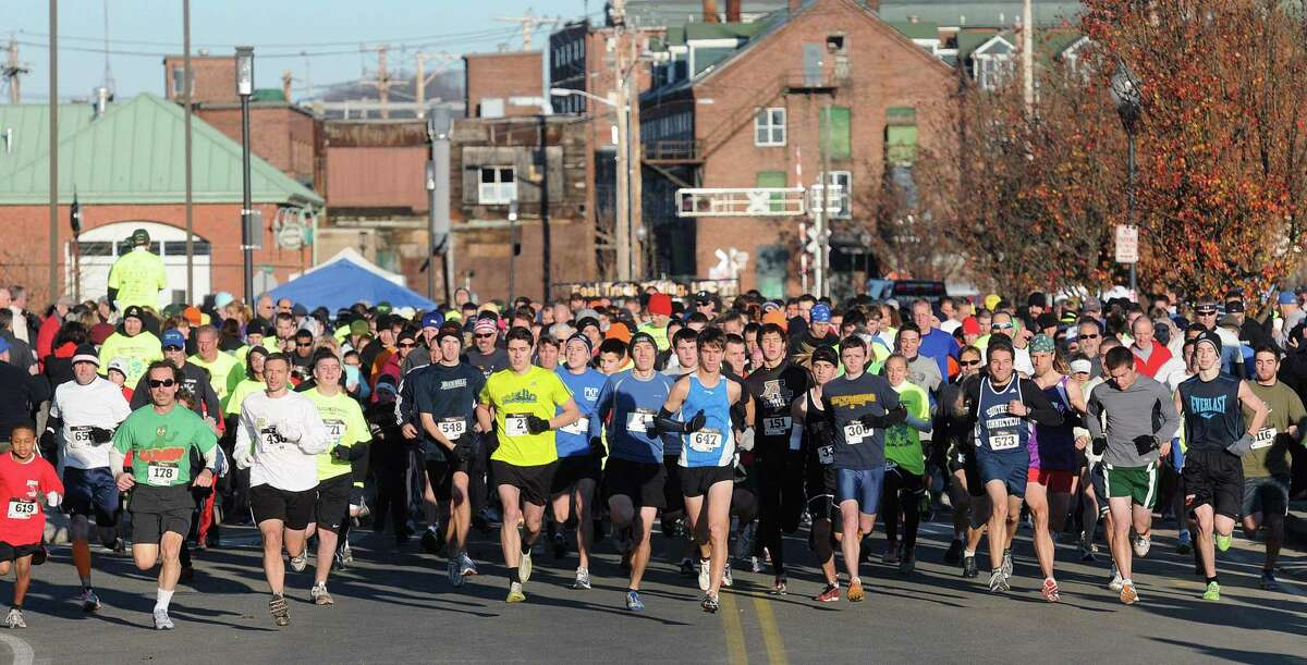 Runners take off at the beginning of the tenth annual Commodore Hull 5k Thanksgiving Day walk, and run event race in a previous year. Registration is now open for the Boys & Girls Club of the Lower Naugatuck Valley's annual Commodore Hull Thanksgiving Day 5k Road Race, sponsored by the water pump supplier in Derby, Greco & Haines. Now in its thirteenth year, the 2021 race will be held both live on Thanksgiving morning, November 25, at the Veteran's Memorial Park in Shelton, and will include a virtual option for people, who would prefer it.