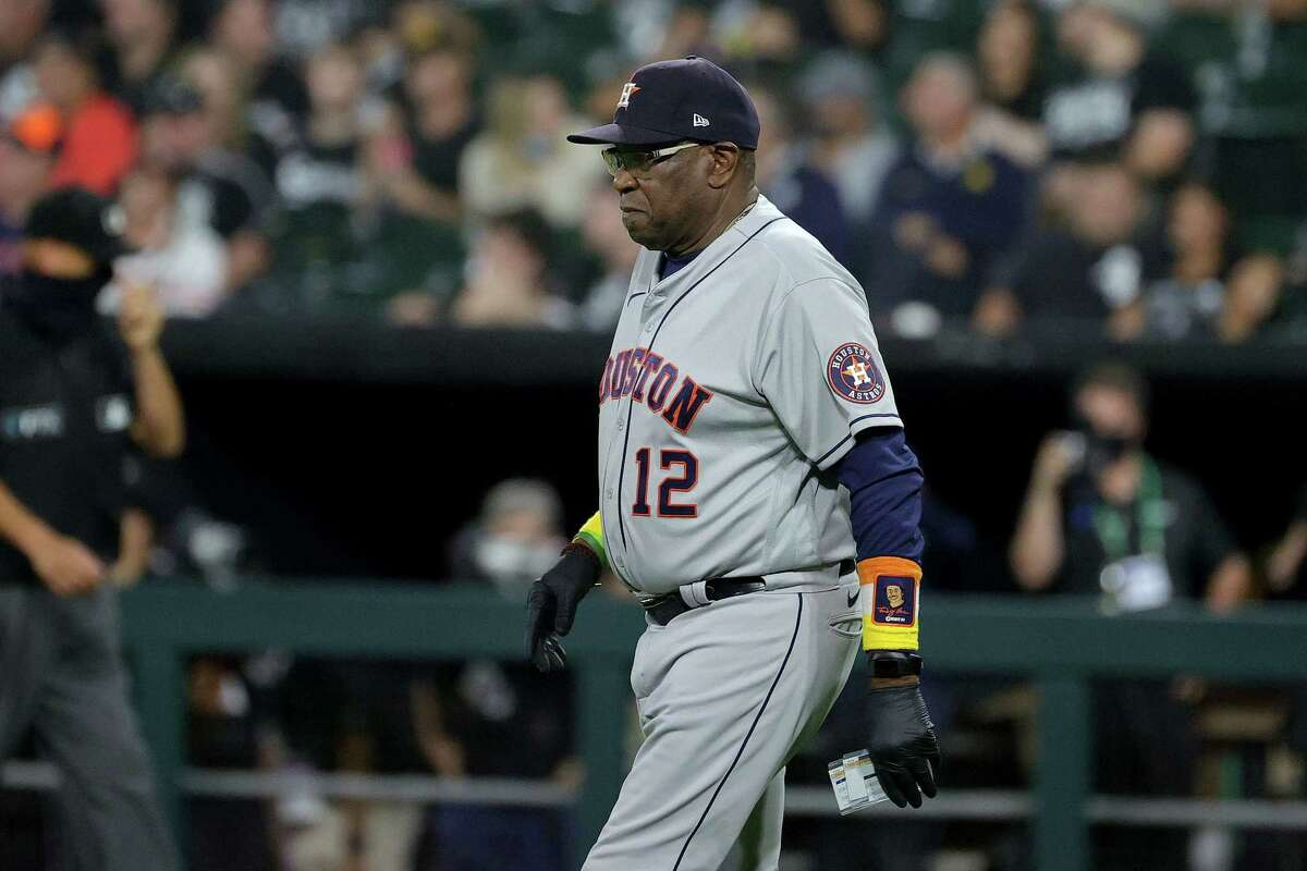 Astros manager Dusty Baker walks on the field for a pitching change in the eighth inning during game 3 of the American League Division Series against the White Sox at Guaranteed Rate Field on October 10, 2021.