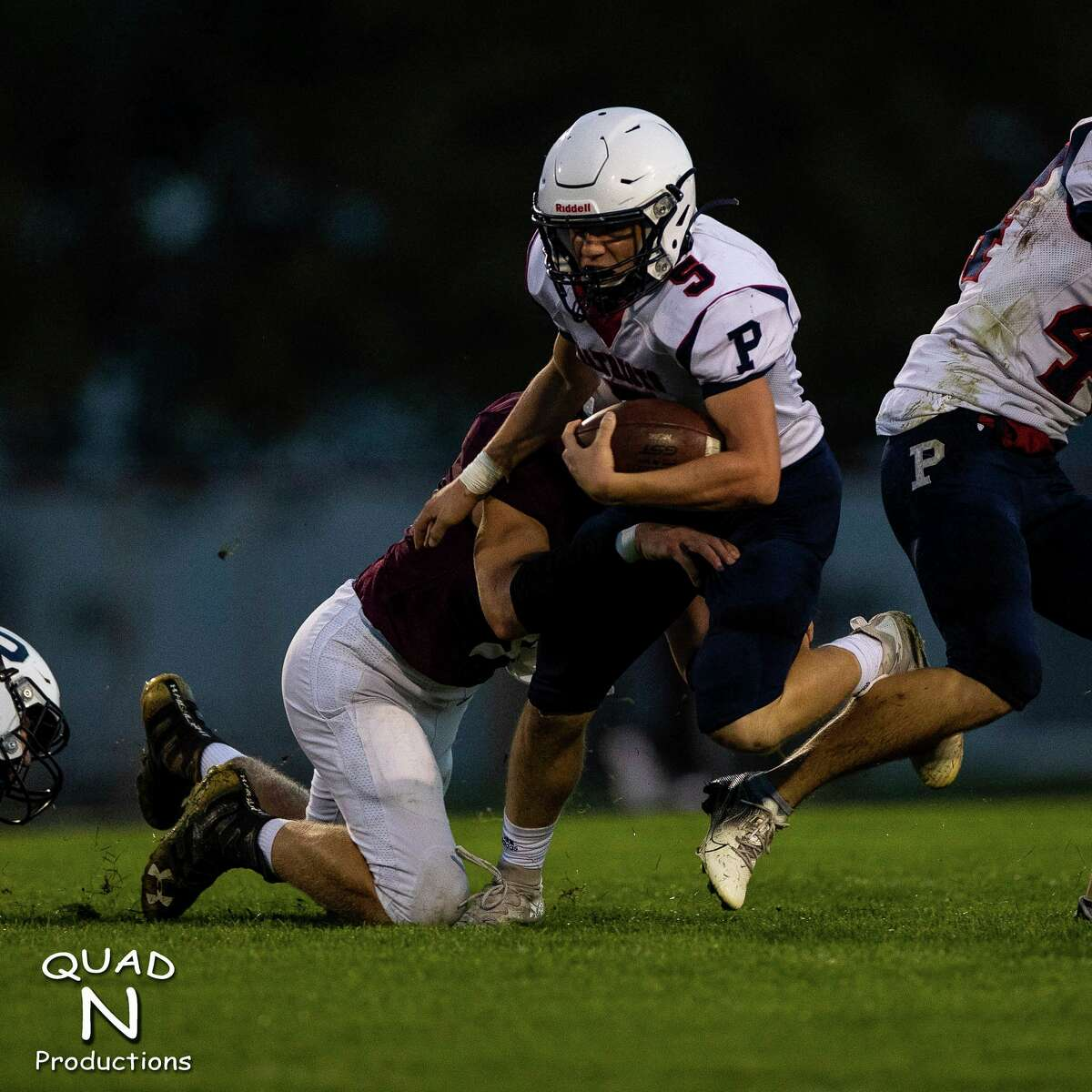 USA's Landon Russell runs to slip a tackle. (Quad N Productions/For the Tribune)