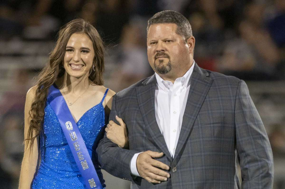 Midland Christian homecoming court nominee McCarly Holloman escorted by her father, Jason, 10/08/2021 at Gorgon Awtry Field. Tim Fischer/Reporter-Telegram