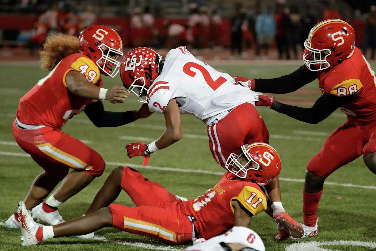 El Campo running back DeKoreyus Ward (2) is surround by Stafford defenders Zephaniah Uta (49), Javon Rhodes (11) and Isaiah Bogerty (88) during the first half of a high school football game Friday, Oct. 8, 2021 in Houston, TX.
