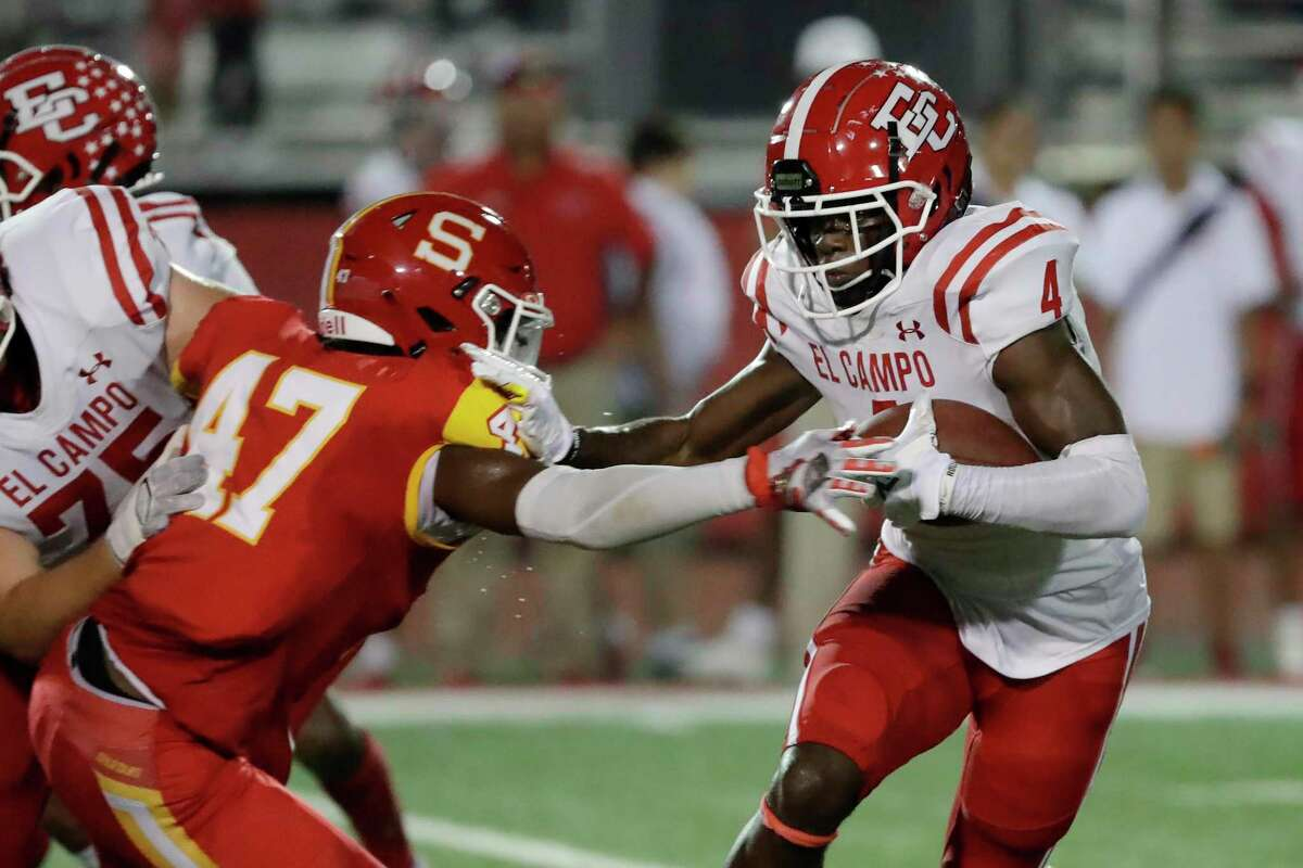 El Campo running back Rueben Owens (4) pushes off Stafford linebacker Julius Nealey (47) during the first half of a high school football game Friday, Oct. 8, 2021 in Houston, TX.