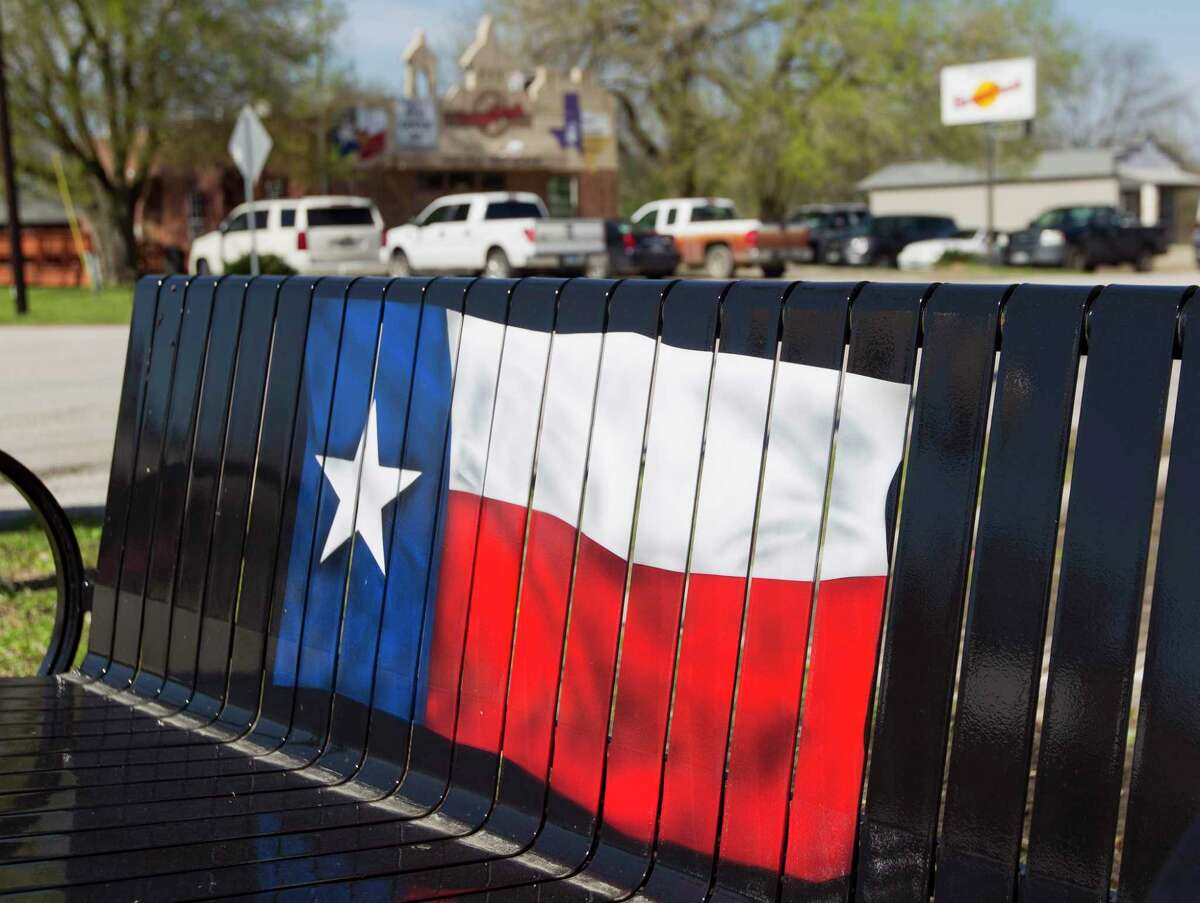 A Texas flag is seen on a bench, Wednesday, Feb. 22, 2019, in Montgomery. The city is holding its first ever fall festival Saturday in downtown historic Montgomery - a day full of live music, fall crafts and unique foods.