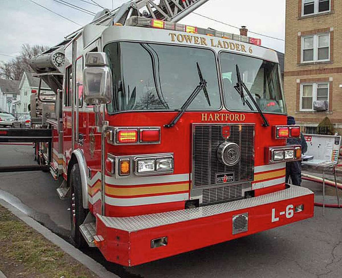 Hartford fire crews extinguished a blaze in a vacant building on Main Street in Hartford, Conn., on Sunday, Oct. 10, 2021.
