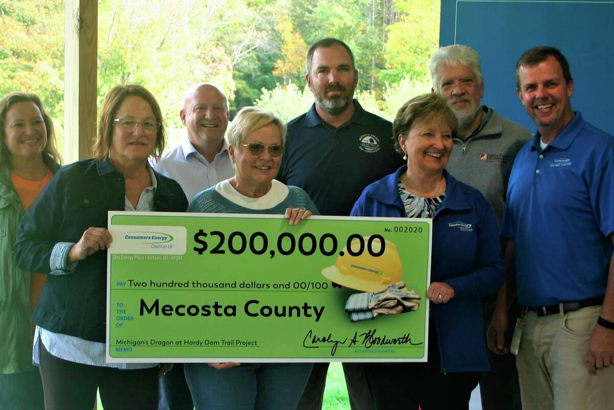 Carolyn Bloodworth presented a check for $200,000 to the Dragon Trail fund during a celebration event this weekend at Brower Park. Pictured areFront row(from left) Mecosta Townshhip supervisor Michelle Graham, Mecosta County commission chairperson Marilyn Bradstrom and Bloodworth. Back row (From left) fundraiser Jodi Albaitis, Mecosta County park board member Eric O'Neil, Mecosta County parks supervisor Jeff Abel, Mecosta County administrator Paul Bullock and Consumers Energy Community Affairs area manager Eric Gustad.