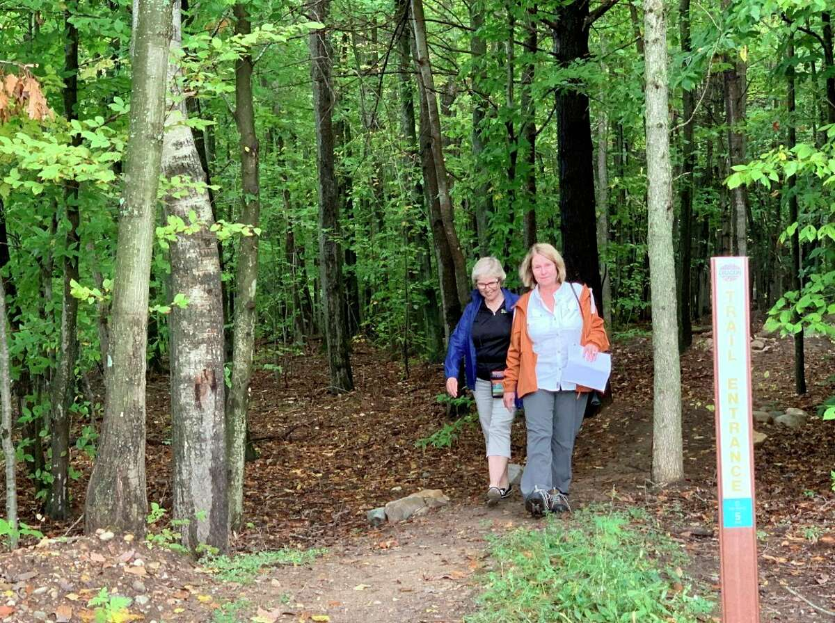 Attendees at the Dragon Trail celebration at Brower Park this weekend take time out to stroll the 1.4 mileBrower Loop section near the deep water channel boat launch. (Pioneer photo/Cathie Crew)