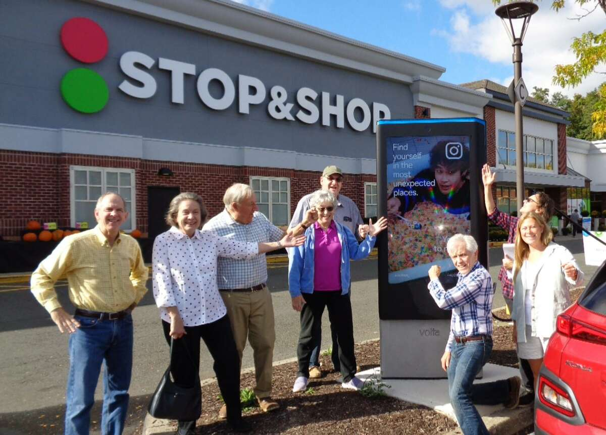 Members of the Ridgefield Action Committee for the Environment recently held a flash mob at Stop & Shop to showcase the store's new electric vehicle chargers.