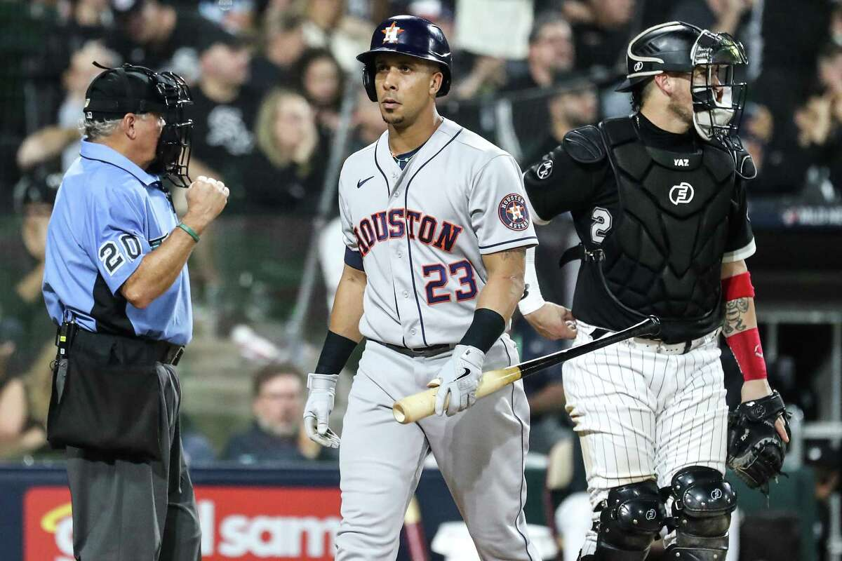 Michael Brantley walks away from the plate after striking out in Sunday's Game 3 in Chicago. Astros batters struck out 16 times in the loss.