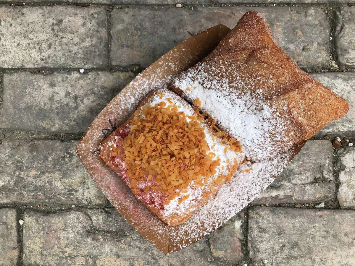 Michael Grimes and Elisa Treviño own The Beignet Stand, which sells a lineup of beignets every weekend at the Pearl Farmers Market. They are opening up a brick-and-mortar on Broadway in coming months.