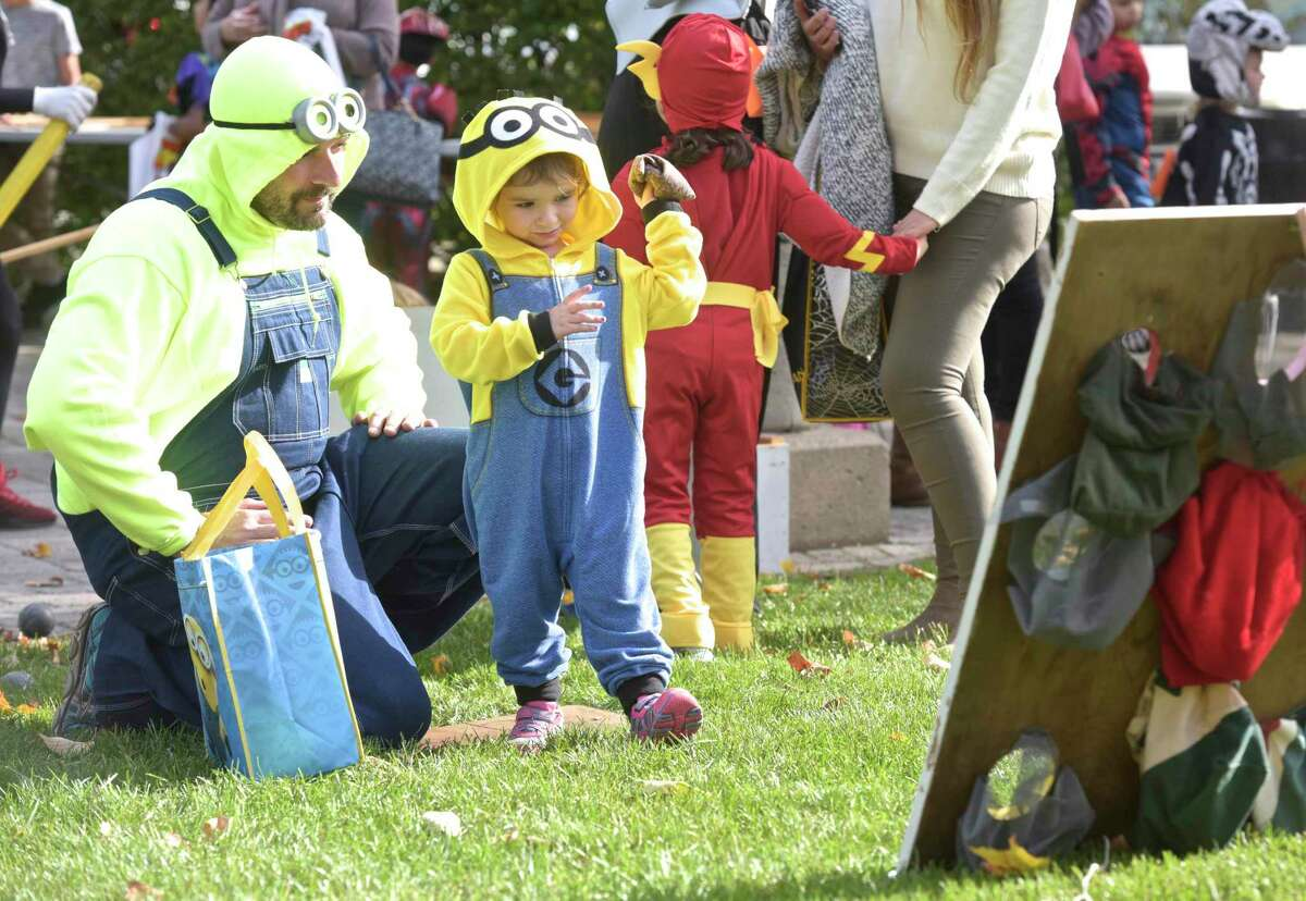 Giovanna Wegrzyb, 2, of New Fairfield, plays a game with his father Chris, at the 25th Halloween on the Green, sponsored by the Kiwanis of Danbury, Danbury Jaycees and CityCenter Danbury. Saturday, October 29, 2017, in Danbury, Conn. The city will host Halloween on the Green on Oct. 30, 2021.