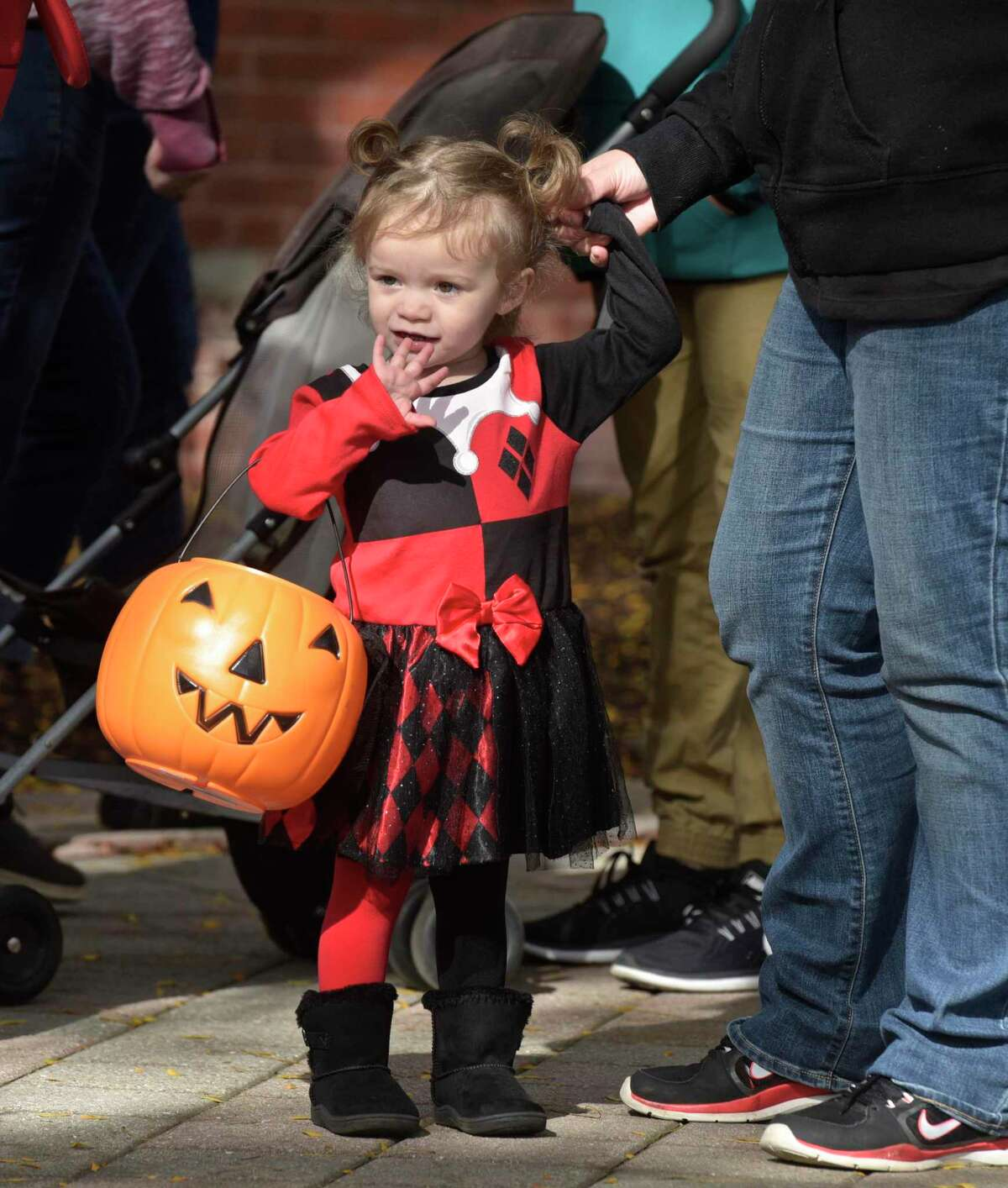 Fiona Hoffan , of Danbury, waits in line with her mother at the 25th Halloween on the Green, sponsored by the Kiwanis of Danbury, Danbury Jaycees and CityCenter Danbury. Saturday, October 29, 2017, in Danbury, Conn. Hoffan is dressed as baby Harley Quinn. The city will host Halloween on the Green on Oct. 30, 2021.