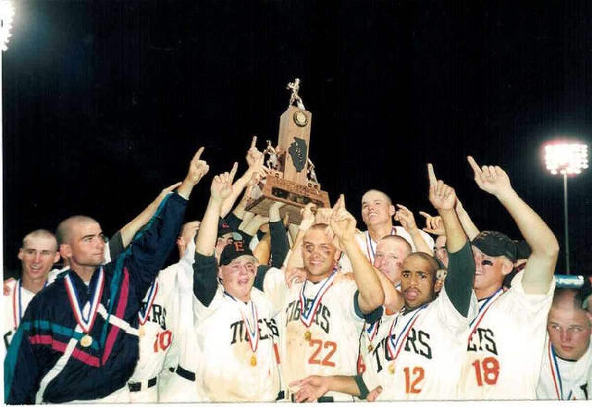 The Edwardsville Tigers celebrate with the Class AA state championship trophy in 1998.
